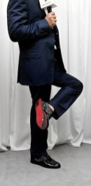 Formula-1-racing-driver-michael-schumacher-showing-the-sole-at-NAVYBOOT-on-FashionDailyMag