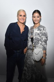 PARIS, FRANCE - SEPTEMBER 24: Maria Grazia Chiuri and Yuko Araki pose backstage after the Christian Dior show as part of the Paris Fashion Week Womenswear Spring/Summer 2019 on September 24, 2018 in Paris, France. (Photo by Victor Boyko/Getty Images) *** Local Caption *** Maria Grazia Chiuri; Yuko Araki
