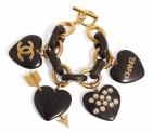 chanel A GOLD METAL AND WOOD CHARM BRACELETCHANEL and BIRKIN handbags x hype christies FashionDailyMag fashion brigitteseguracurator