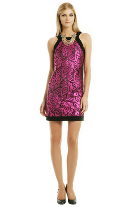 Make a statement as you prance into the party wearing this pink lace dress by Moschino Cheap and Chic.