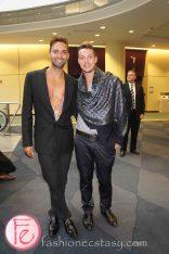 2012 Brazilian Carnival Ball - Miguel & Gui wearing: Chio Di Stefania D (Left); LV scarf, Gucci belt, Lucian Matis pants (Right)