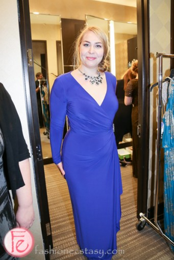 Eliza Johnson wearing blue sapphire necklace and blue gown