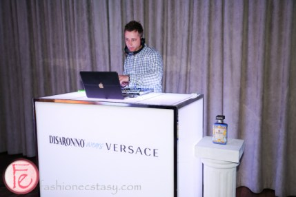 dj at disaronno wears versace launch party spoke club