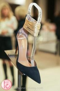 black heels with gold ankle belt