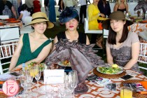 ladies in ascot hats at polo for heart 2015