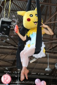acrobatic performers on trapezes in pokemon costume