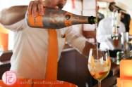 pouring veuve clicquot rich champagne