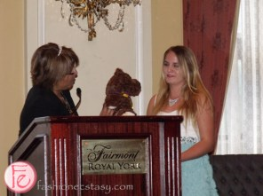 Ms. Meharchand giving a Starlight bear to Clarissa