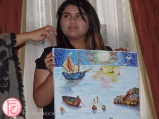 Sahar, Starlight child donating her painting Moonlight Pointilism
