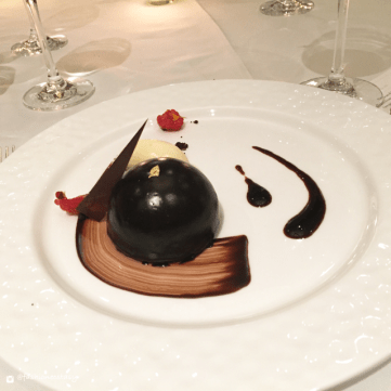 chocolate meringue cake garnished with gold leaves ritz
