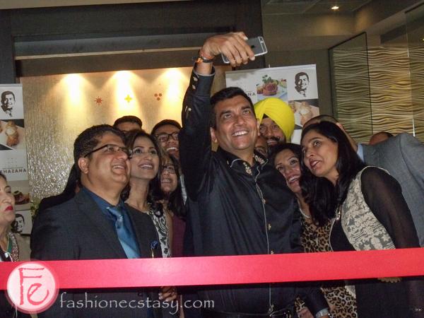 Sanjeev Kapoor takes a selfie before Khazana Restaurant ribbon-cutting