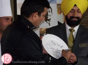 Sanjeev Kapoor autographs the first plate for Khazana, Brampton