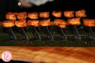 a row of grilled shrimp