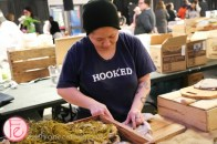 kristin donovan of hooked shucking oyster