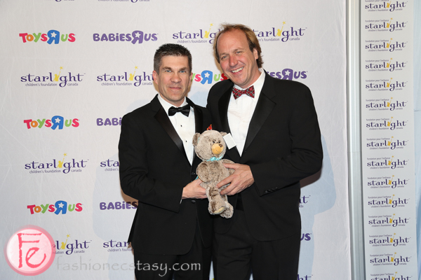 Patrick Lefrancois (Gala Chair) & Brian Bringolf (Starlight Executive Director) holding Quinn, Starlight's collectible bear