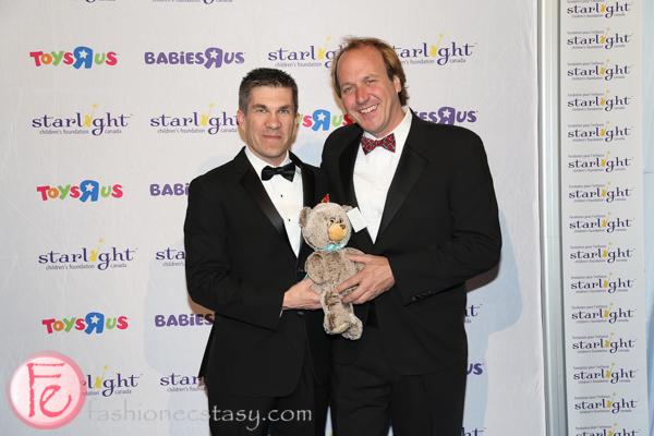 Patrick Lefrancois (Gala Chair) & Brian Bringolf (Starlight Executive Director) holding Quinn, Starlight's collectible bear
