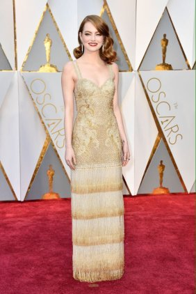 Emma Stone - Givenchy Haute Couture and Tiffany & Co jewellery.