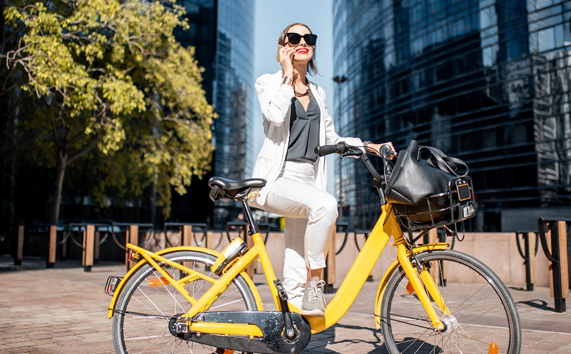 woman-with-yellow-electric-bike-outside-main-image
