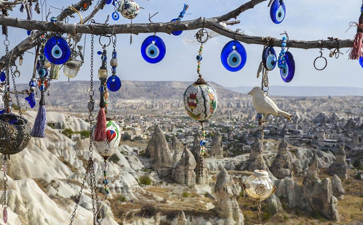 evil-eye-necklaces-hanging-from-tree-in-desert-1000x600