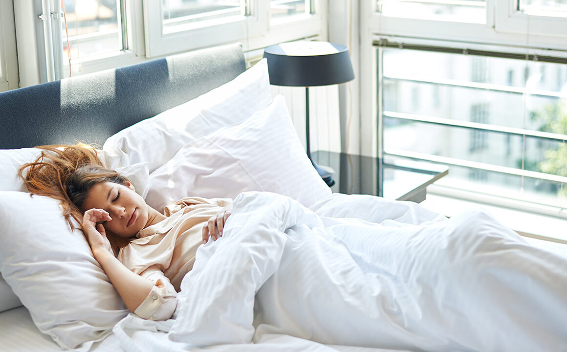 how-sleep-affects-your-physical-health-woman-getting-great-sleep-happy