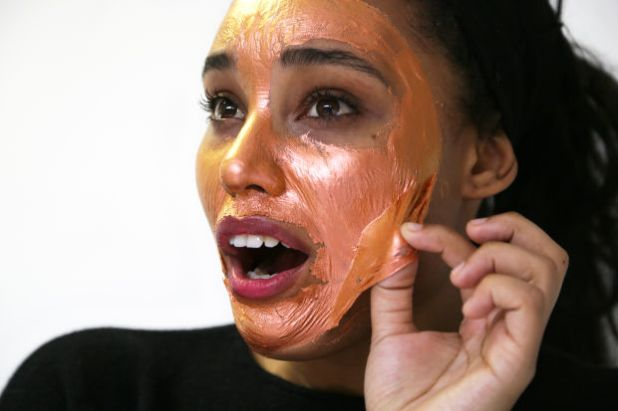 """<p><strong>Origins GinZing Peel-Off Mask to Refine and Refresh, $26, <a href=""""http://rstyle.me/~9WCDL"""" rel=""""nofollow"""">available at Macys</a>:</strong>Chloe's favorite mask in the group (and hands-down the most photogenic, too) Origins' rose-gold mask made her look like a """"gilded angel...or an extra on <em>Game of Thrones</em>."""" She did report that peeling it off required a bit of tugging and hurt a tiny bit, but the smooth, glow-y results made that momentary discomfort so worth it.</p>"""