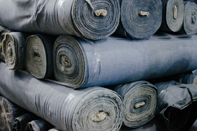 Denim rolls waiting to be cut and sewn. Photo: Whitney Bauck/Fashionista