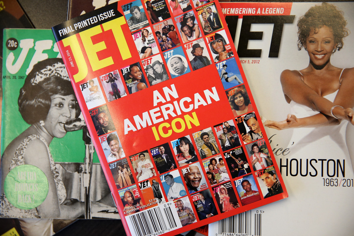 """The final print edition of """"Jet"""" magazine displayed with vintage copies of the magazine. Photo: Scott Olson/Getty Images"""