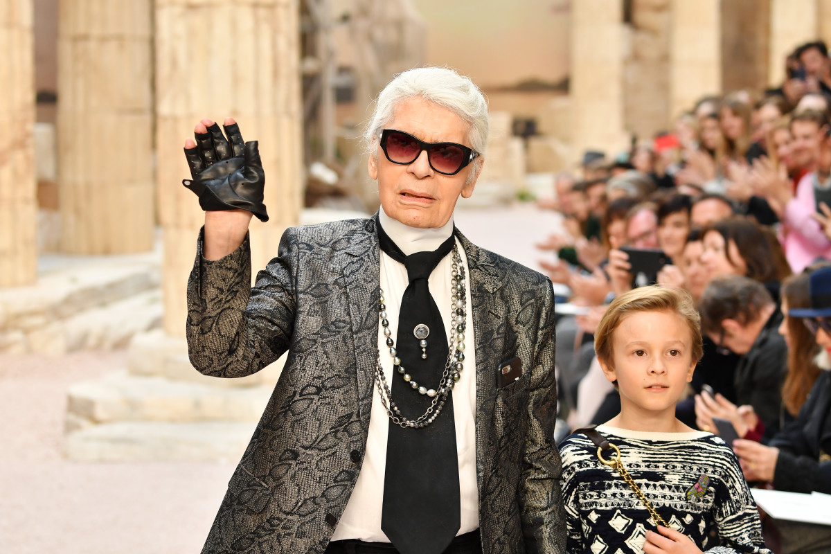 Karl Lagerfeld and godson Hudson Kroenig during the finale of Chanel's Cruise 2018 show at the Grand Palais in Paris. Photo: Pascal Le Segretain/Getty Images