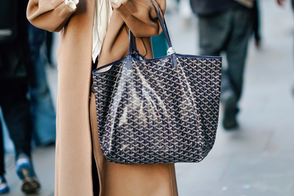 A navy canvas Goyard carryall, which starts at $1,150. Photo by Edward Berthelot/Getty Images