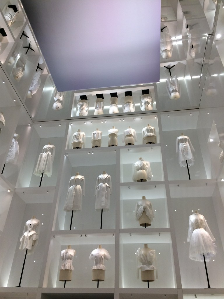 A section of the atelier portion of the exhibit, displaying designs all in white