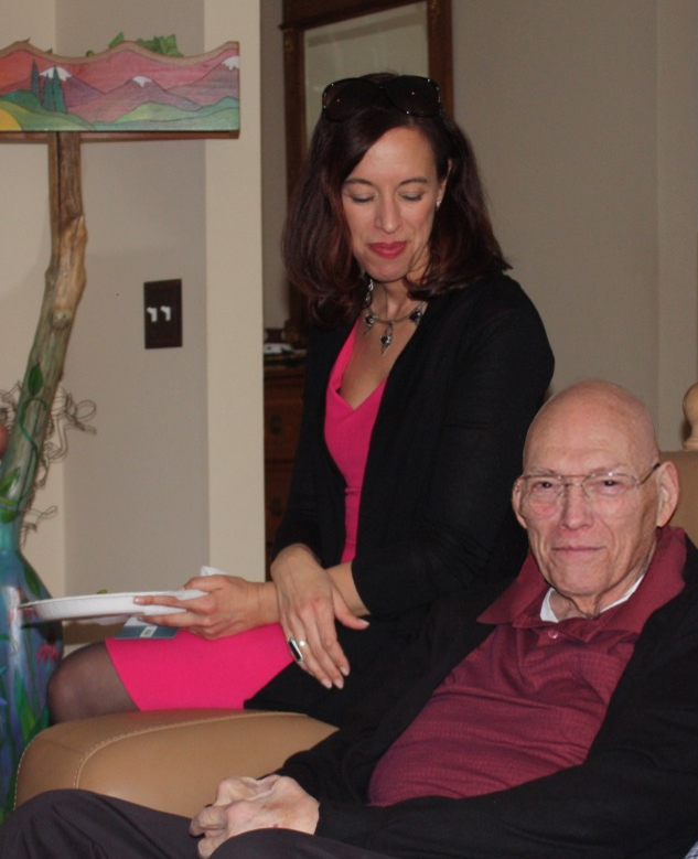 """Professor Scafidi, seated above and looking at her father, Arnauld F. """"Scotty"""" Scafidi"""