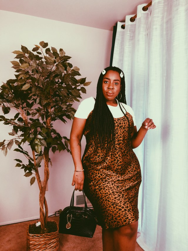 Black woman in slip dress