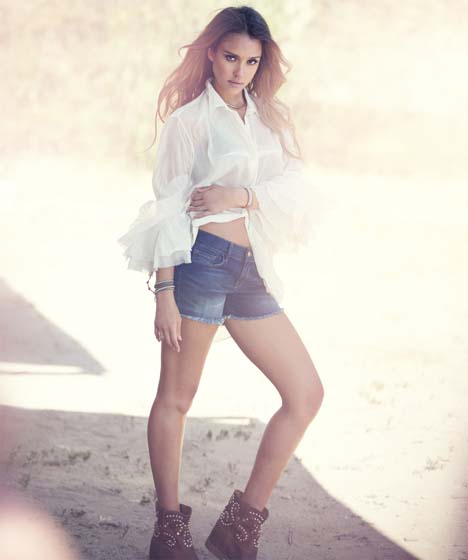 Top by Acne, shorts by Frame Denim and necklace and boots by Isabel Marant.