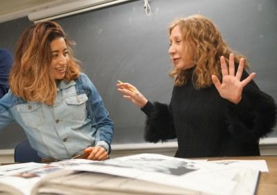 Reem Acra critiquing student