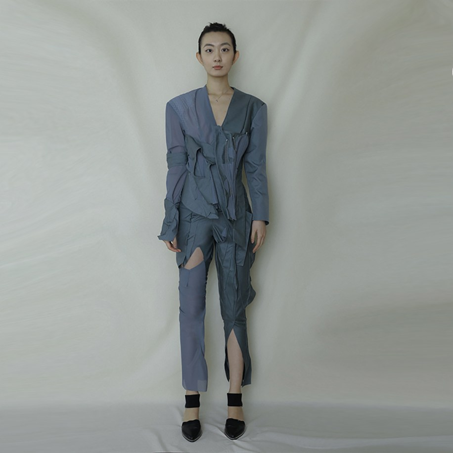 FRONT VIEW (DECONSTRUCTED JACKET AND PANTS, SHEER AND TAILORED FABRICATION , TORN UP, RECONSTRUCTED WITH BONING STRUCTURES)
