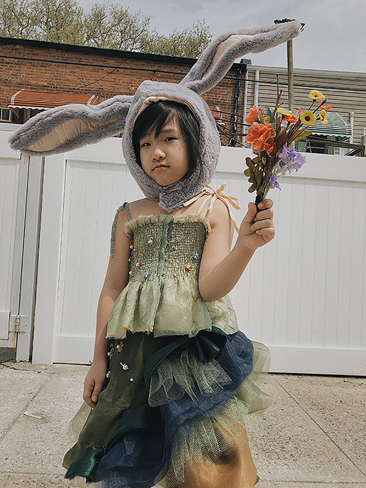 Double fabrics smocking top with multiple layers organza skirt.