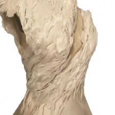 Hand sewn ivory feathers on organza layered over a mesh foundation with spiral boning