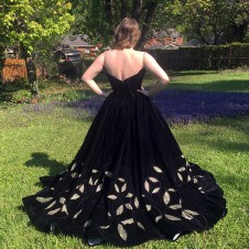 Velvet ball gown with gold chain straps and reverse applique embroidery revealing gold tulle