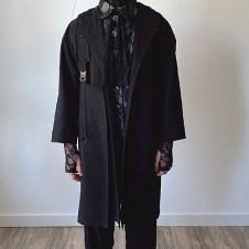 "Black ""oxygen bag"" jacket with lace shirt filled with batting and lace pant, mask, gloves and socks (front view)"