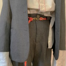 detail shot of red selvage detailed off-white shirt, and oversized dark grey suit