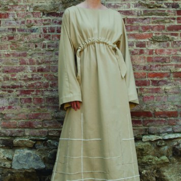 Kimono sleeve long dress with drawcord cinched waist and yarn embroidery at bottom.