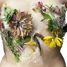 PVC corset embellished with a mixture of real flowers & resin developed by the designer.