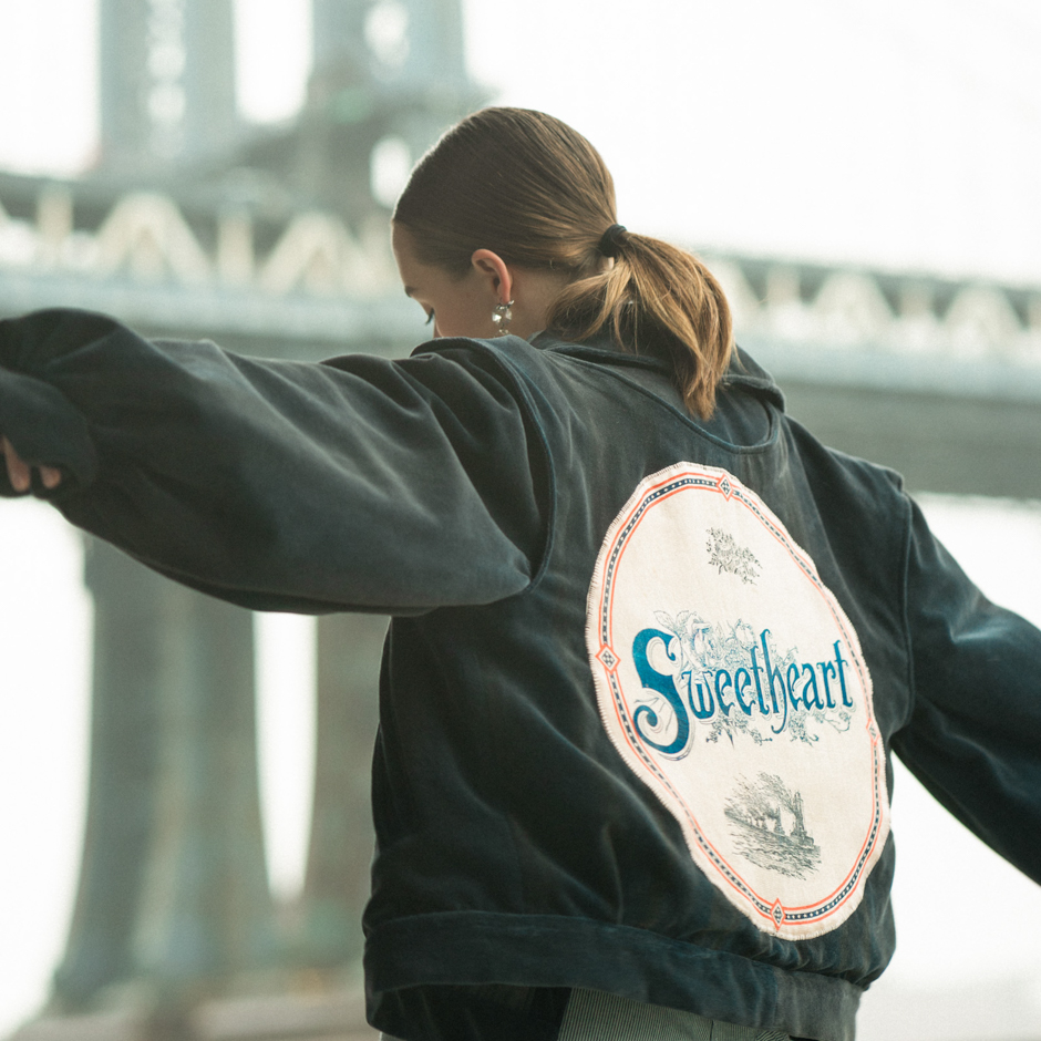 """Photo 4 - Back view of Navy velvet bomber, with pink satin back patch that says """"Sweetheart""""."""
