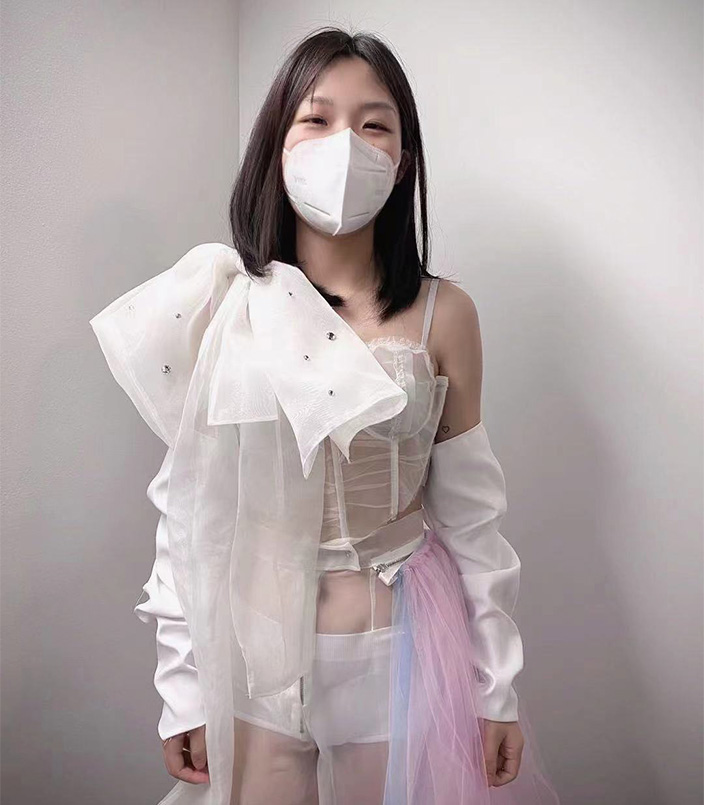 Decoratively transparent corset with organza bow on shoulder strap