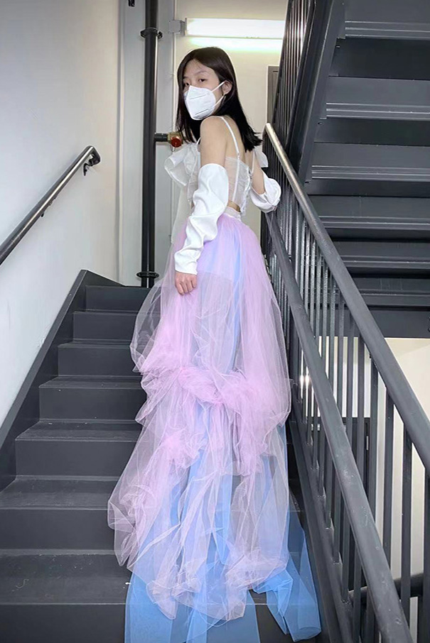 Layers of blue and pink tulle drape with artistic placement.