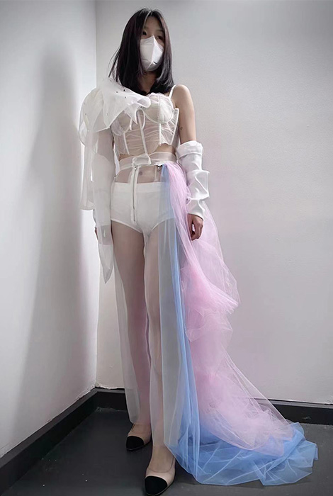 Decoratively transparent corset with bow strap. Sheer organza pants with colorful zip-on tulle dresses and pull up sleeves.