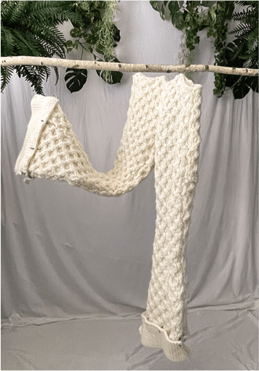 Gabriela Villatoro Collection Photo 2 - Knitted white pants, hanging from wooden stick