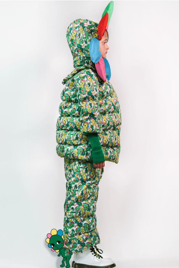 Side view profile of the puffer suit with the detachable flower petal hood.