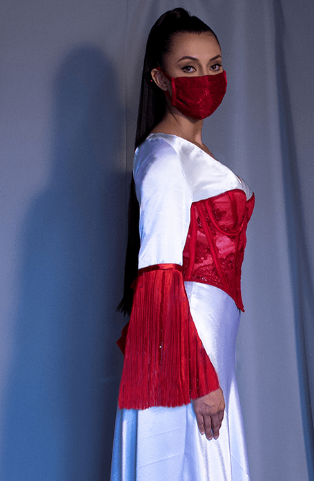 The corset and the fringe (at end of the sleeve) were delicately beaded to give emphasis to the red. The corset is boned to provide support around the waist.
