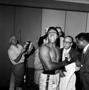 Boxer Ali and (later known as Muhammad Ali) weighing in before championship fight vs. Liston.